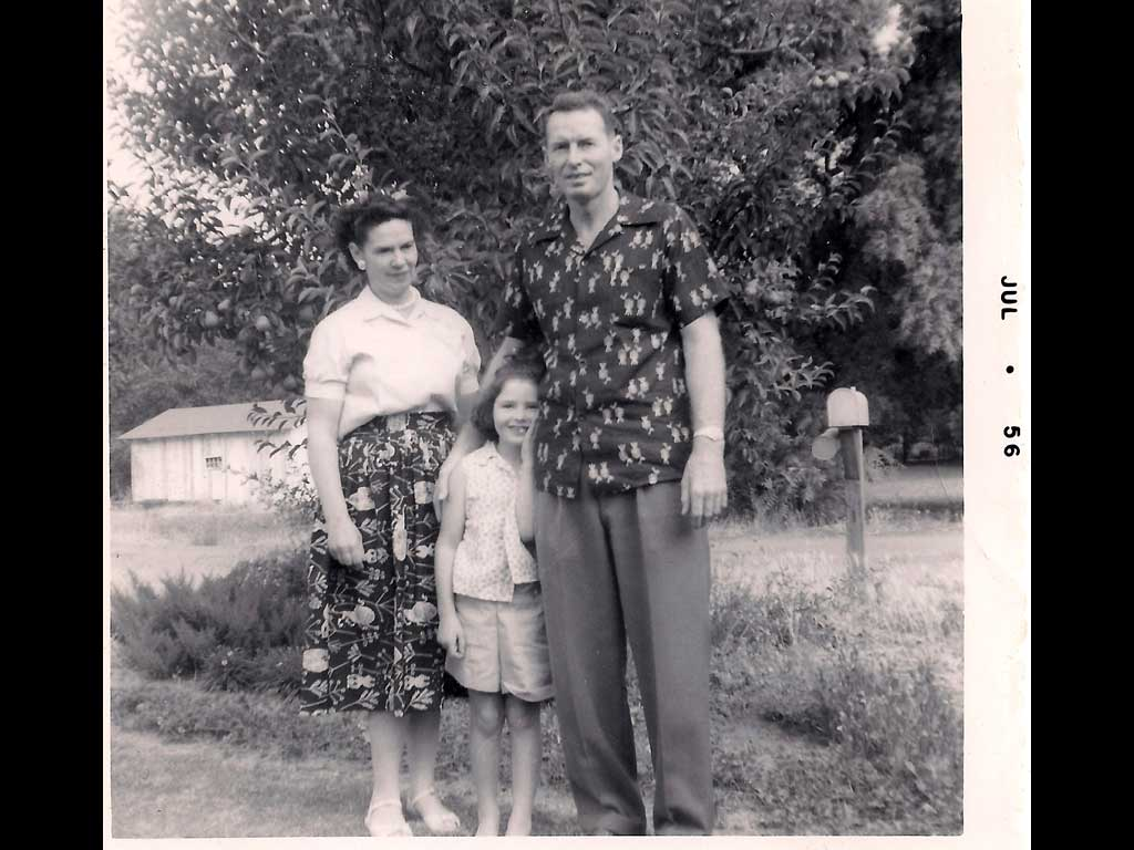 Laura and parents 1956