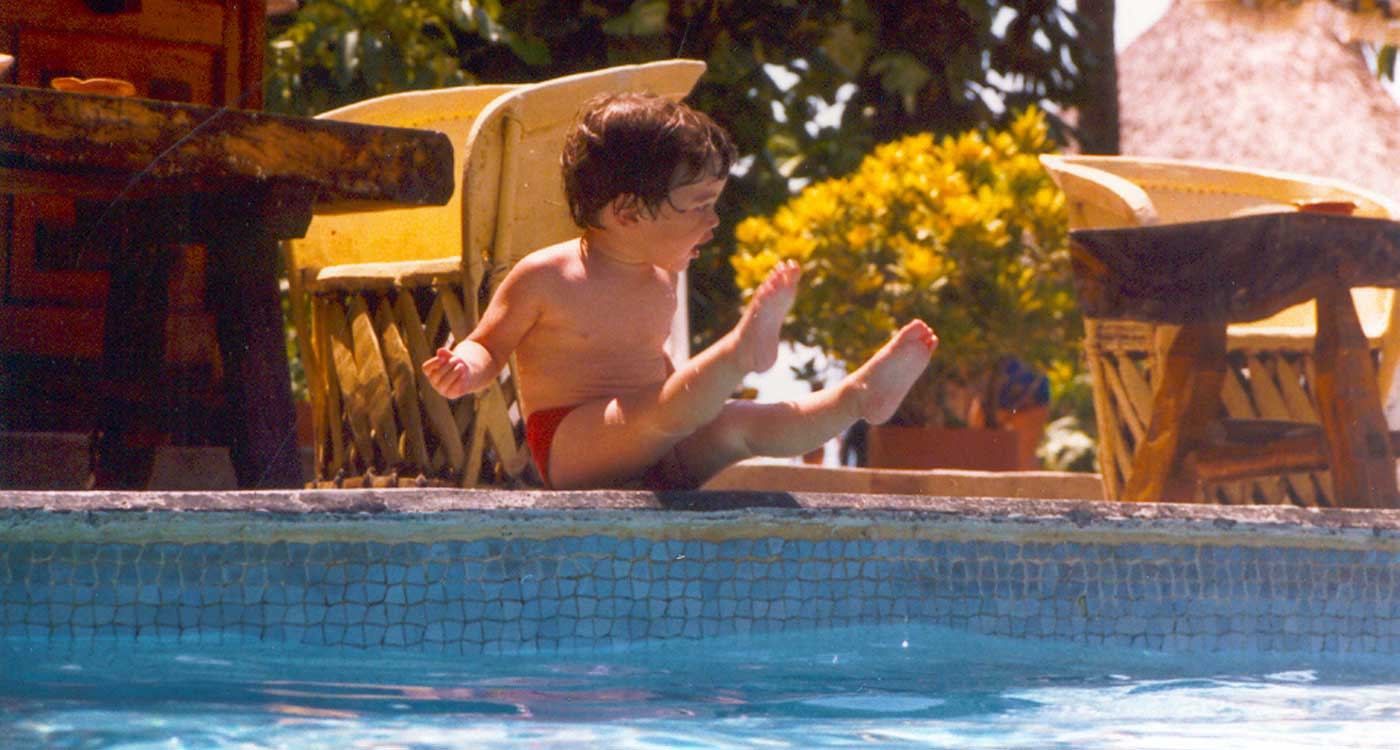 Daniel lounging by the pool in Puerto Vallarta